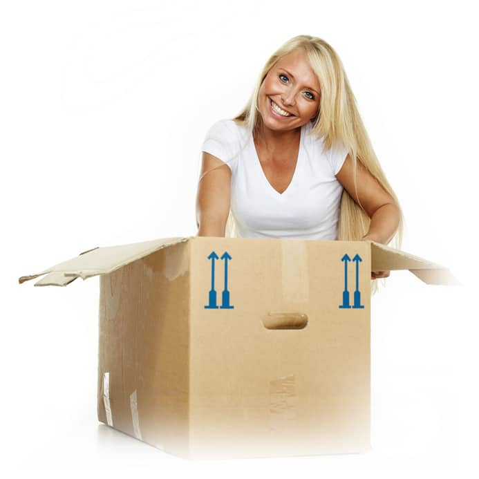 Young woman clutching something in a moving box