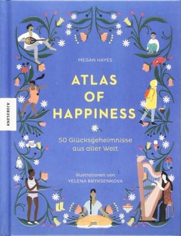 """Bild von blauem Buch mit Titel """"Atlas of Happiness"""""""