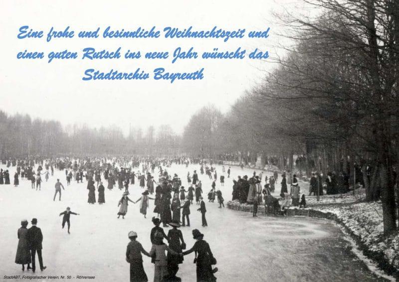 Eine frohe und besinnliche Weihnachtszeit und einen guten Rutsch wünscht das Stadtarchiv Bayreuth. Weihnachtsgruß des Stadtarchivs Bayreuth. Foto ca. 1910 - Schlittschuhlaufen auf dem Röhrensee.