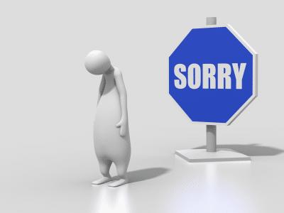 betrübtes männchen vor Schild 'Sorry'